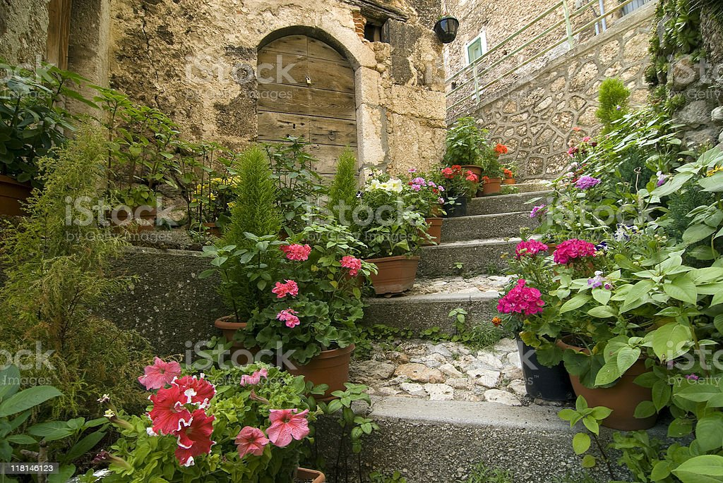 Calascio (L'Aquila, Italy), old village with flowers in Abruzzi royalty-free stock photo