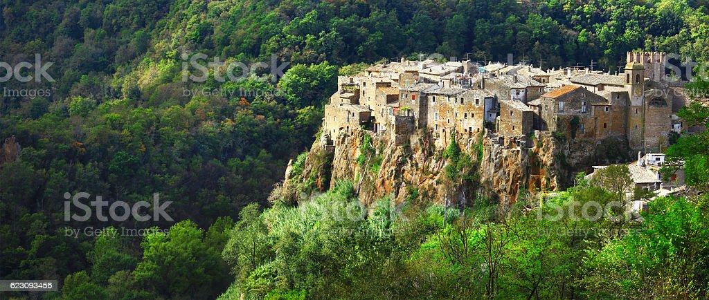 Calcata -hill top village at tuffa rocks, Italy stock photo