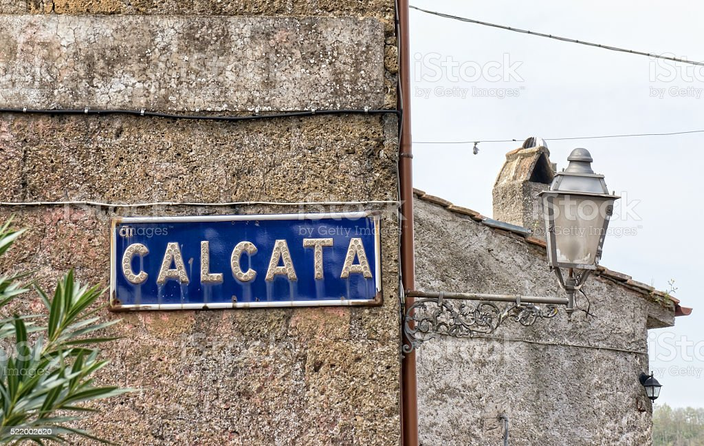Calcata sign on old wall stock photo