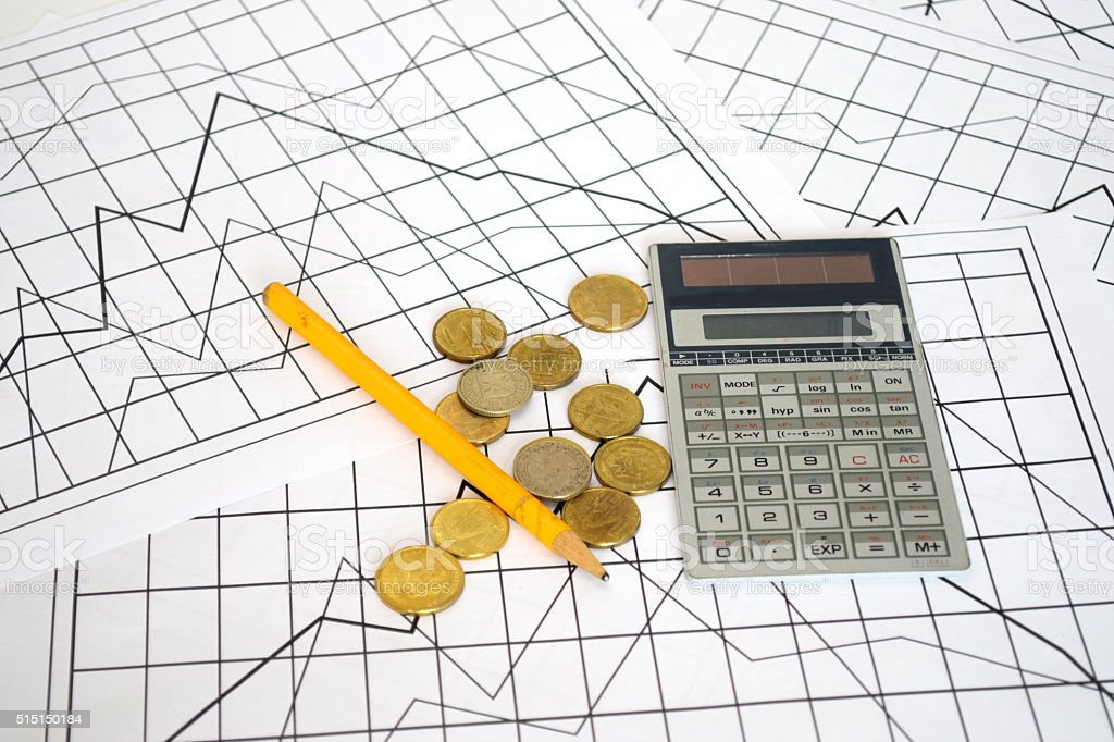 Calculating costs and earnings stock photo