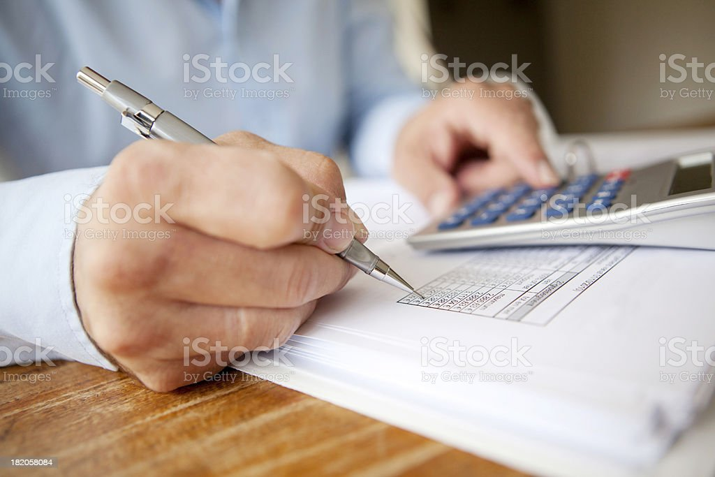 calculating finances stock photo