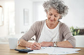 Calculating her expenses for the month