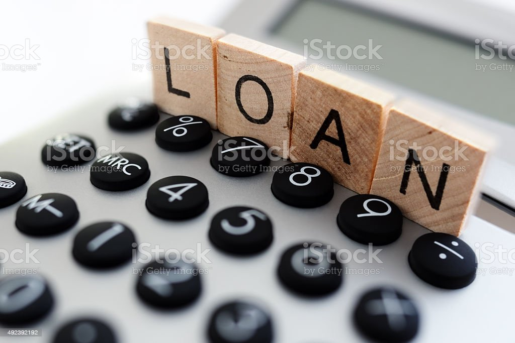 Calculating loan repayments stock photo