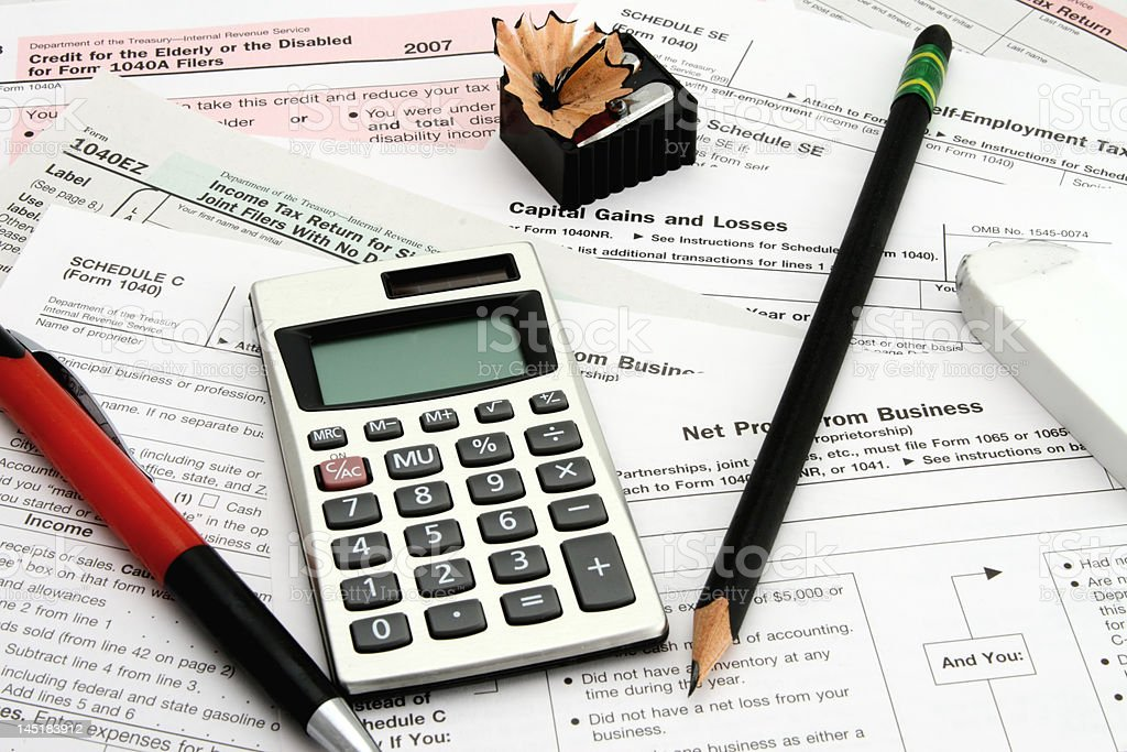 Calculating Taxes stock photo