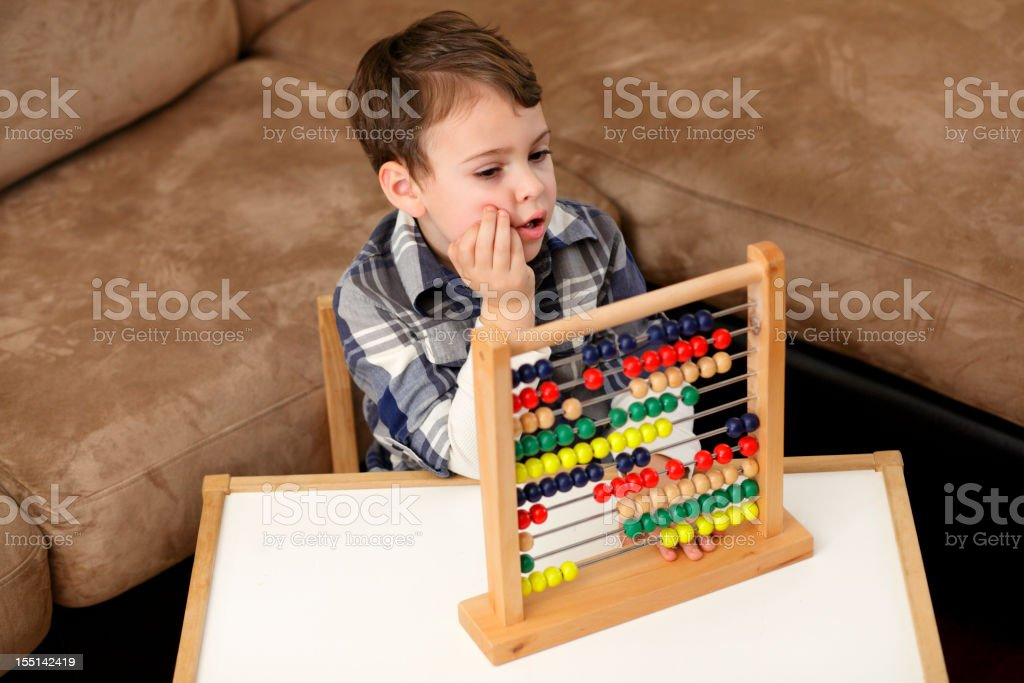 Calculating with an abacus royalty-free stock photo