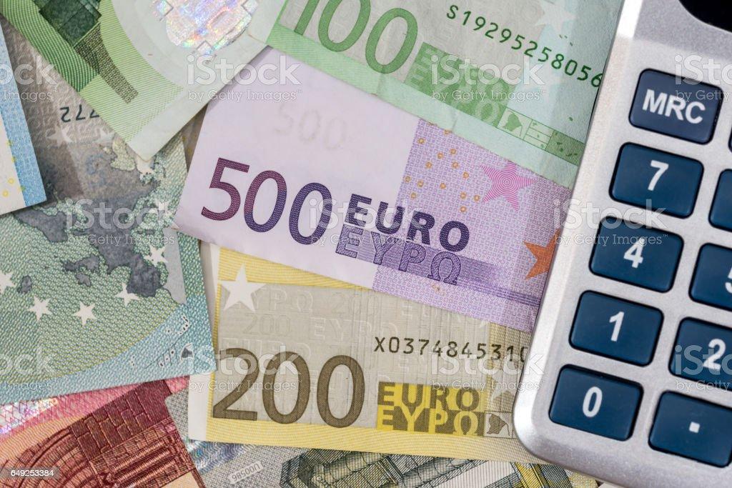calculator above euro banknotes. stock photo