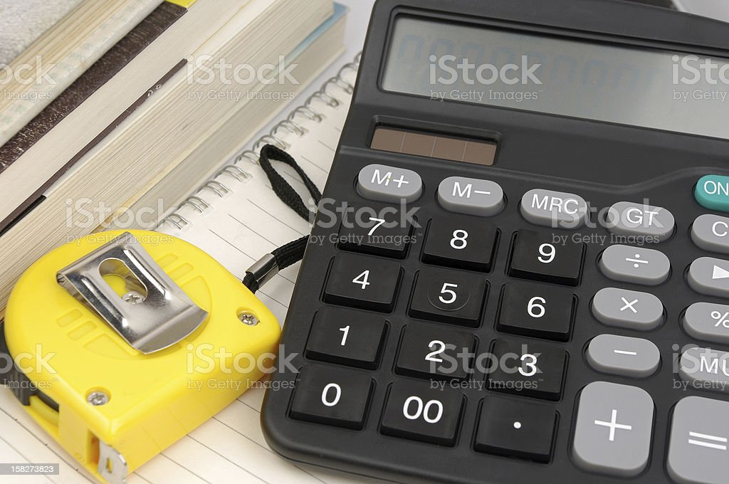 Calculator and a ruler royalty-free stock photo