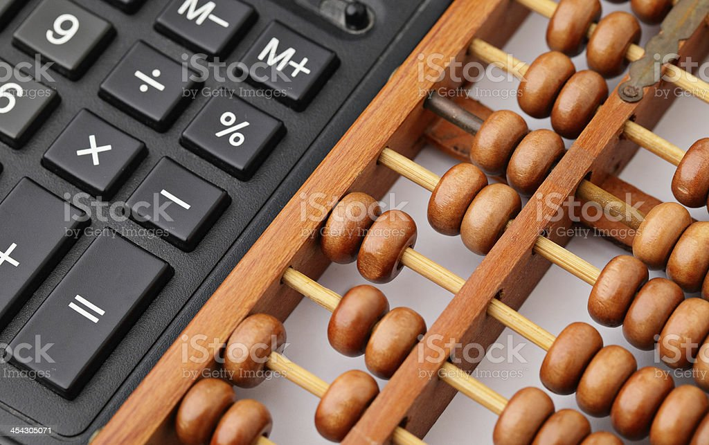 Calculator and abacus royalty-free stock photo