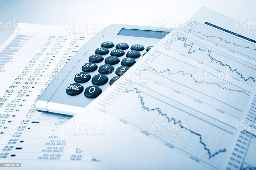 Calculator and charts stock photo