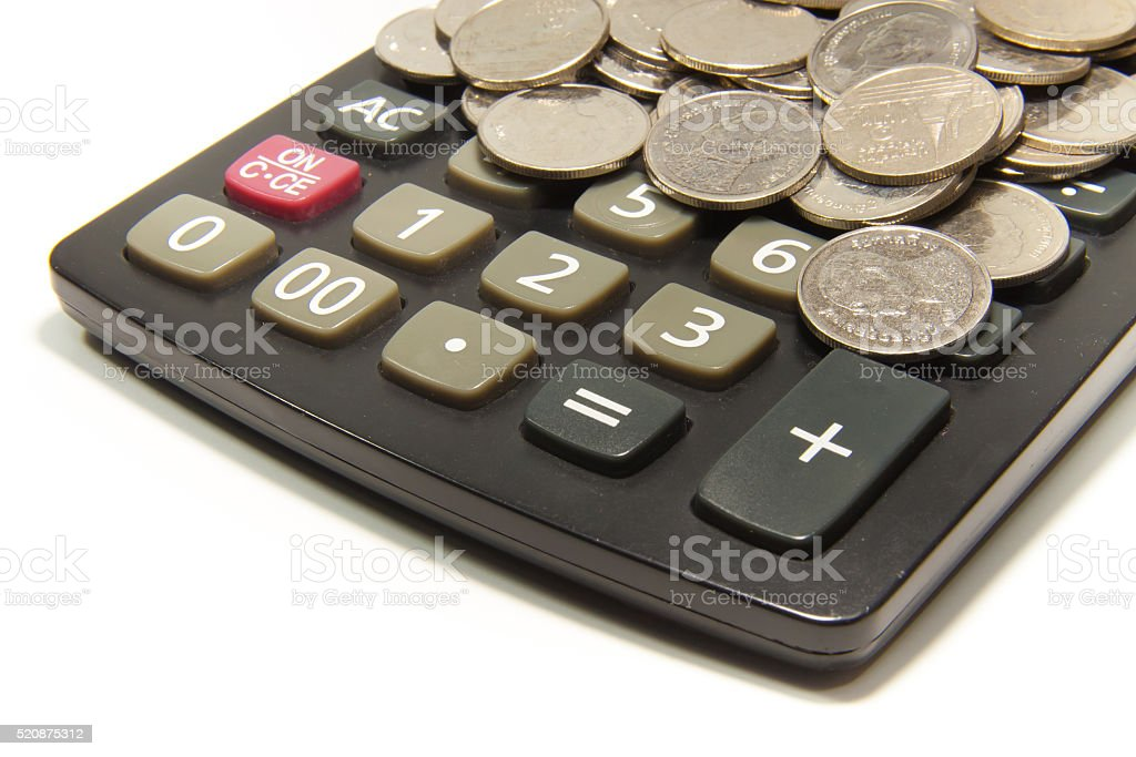 Calculator and coin on the white background royalty-free stock photo