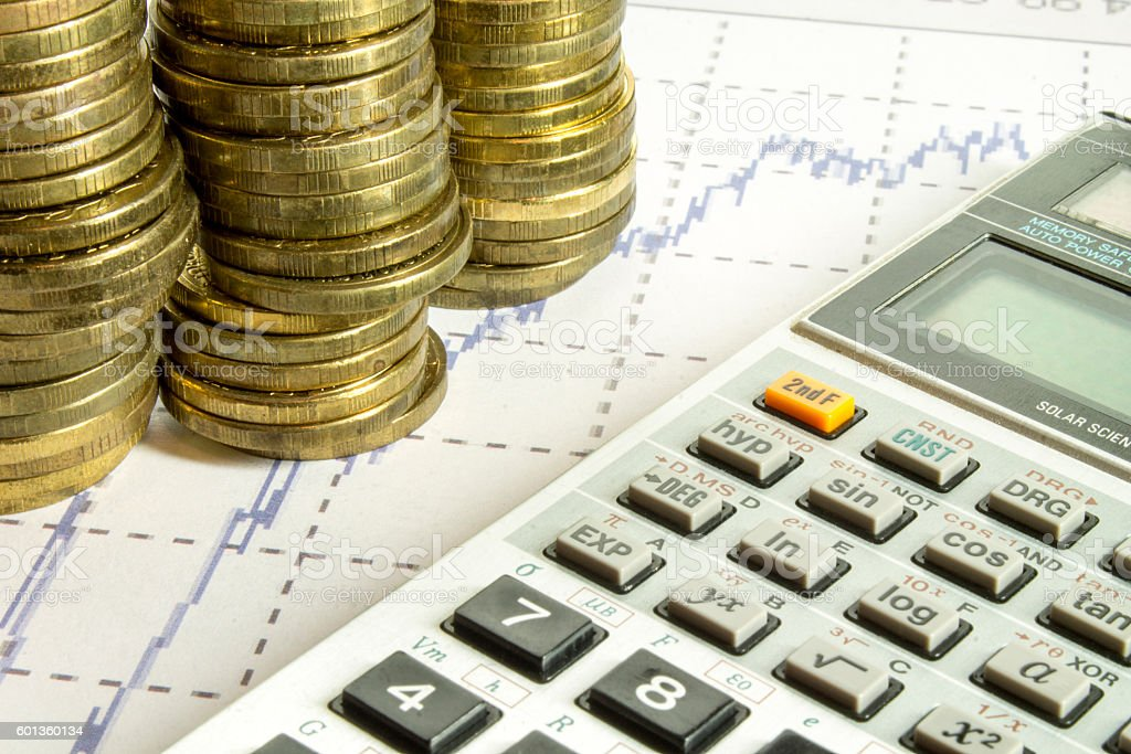 calculator and coins on graffica the Dow Jones stock photo