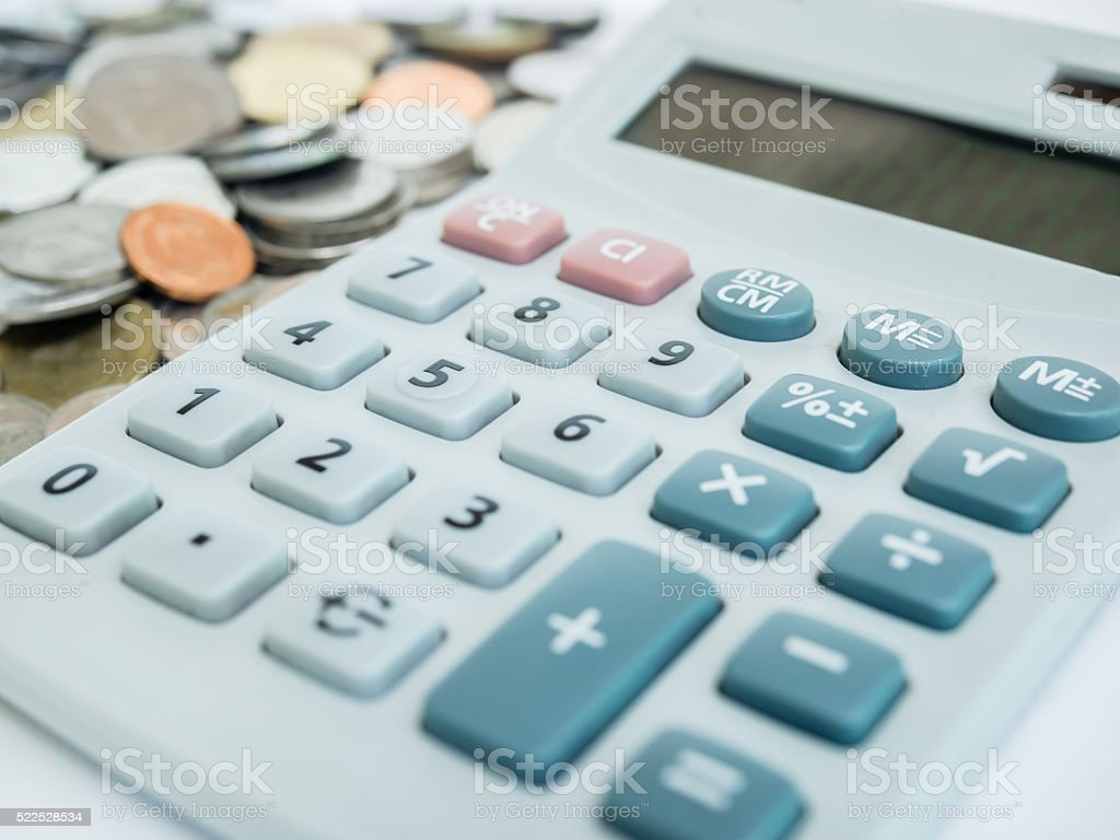 Calculator and coins. stock photo