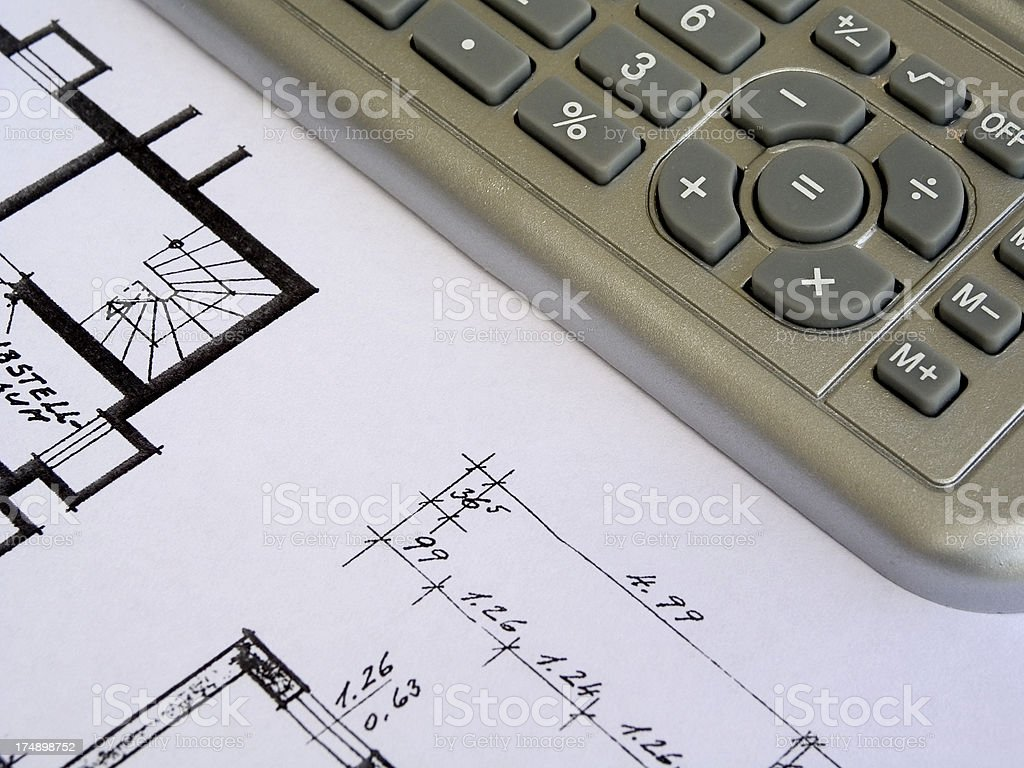 calculator and construction plan royalty-free stock photo