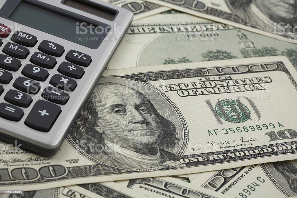 calculator and dollars stock photo