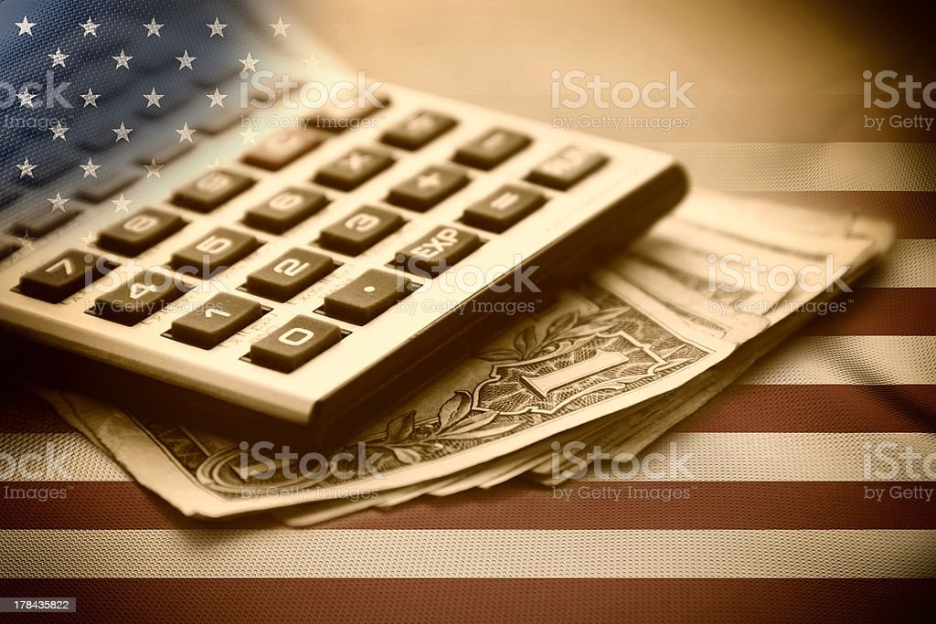 Calculator and Dollars stock photo