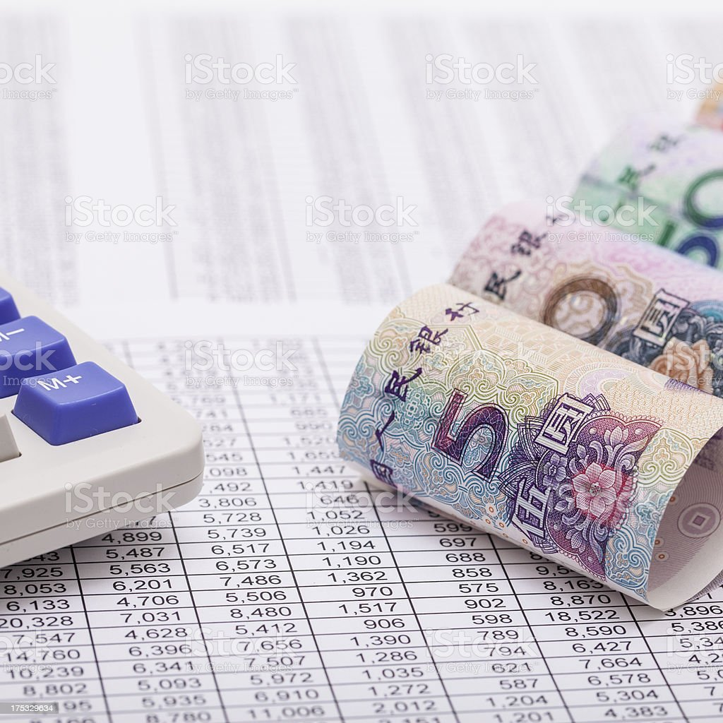 RMB, calculator and financial reports stock photo