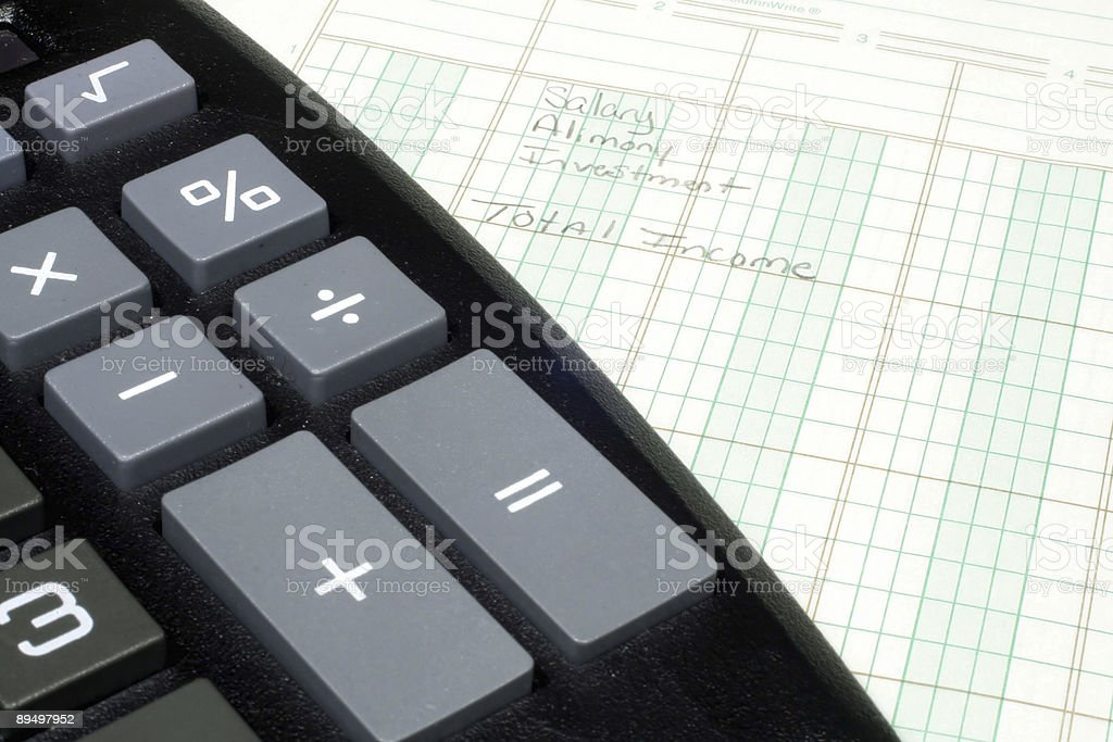 Calculator and Ledger Paper stock photo