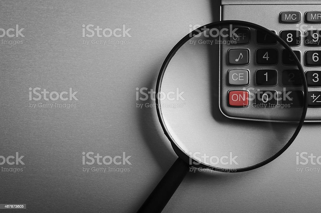 calculator and magnifying glass royalty-free stock photo