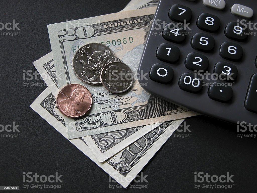 Calcolatrice e denaro foto stock royalty-free