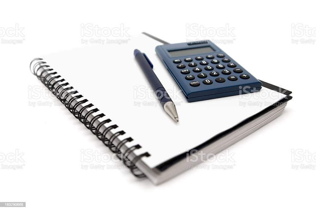 Calculator and pen on a wire bound notebook, on white royalty-free stock photo