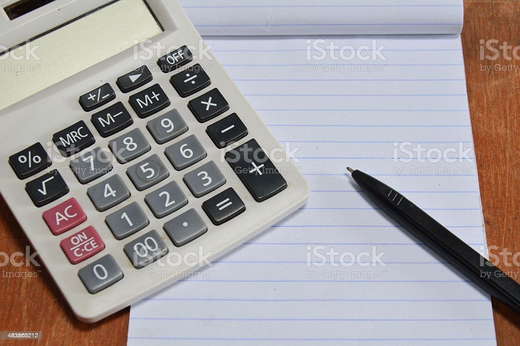 calculator and pen on book stock photo
