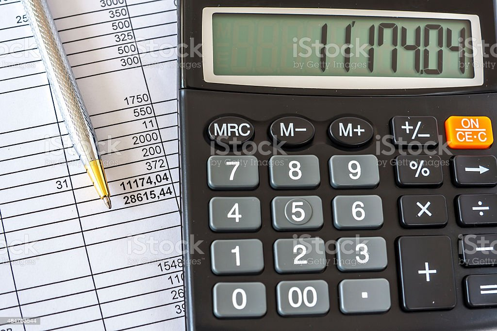 Calculator And Pen On Business Document stock photo