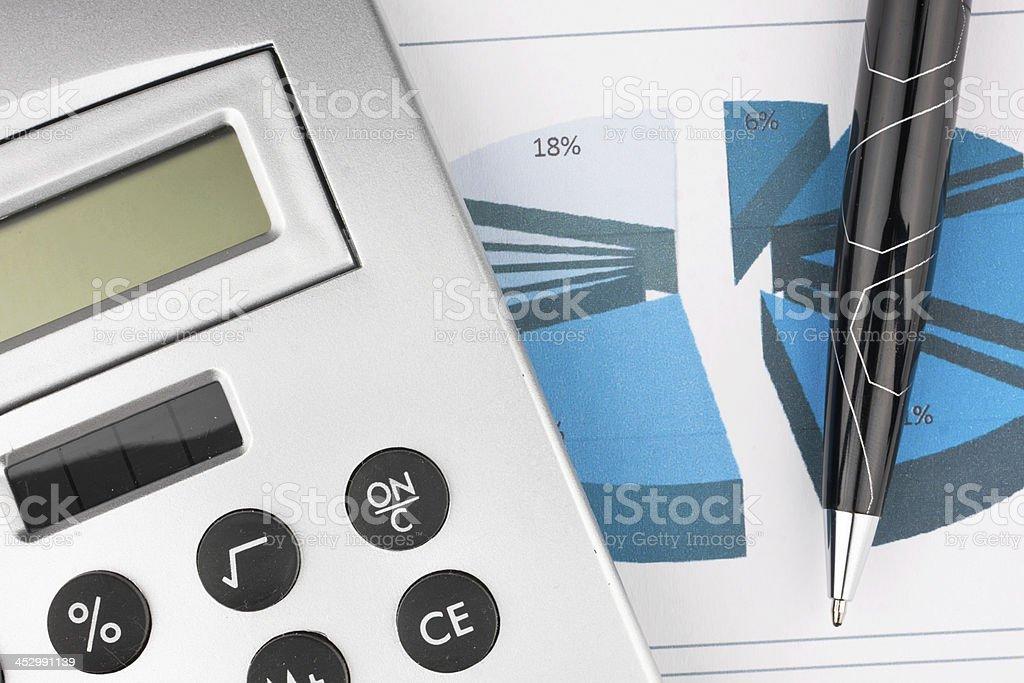 calculator and pen stock photo