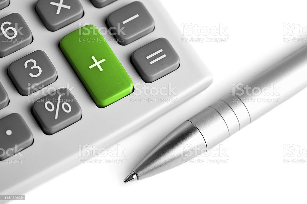 calculator and pen. plus button colored green stock photo