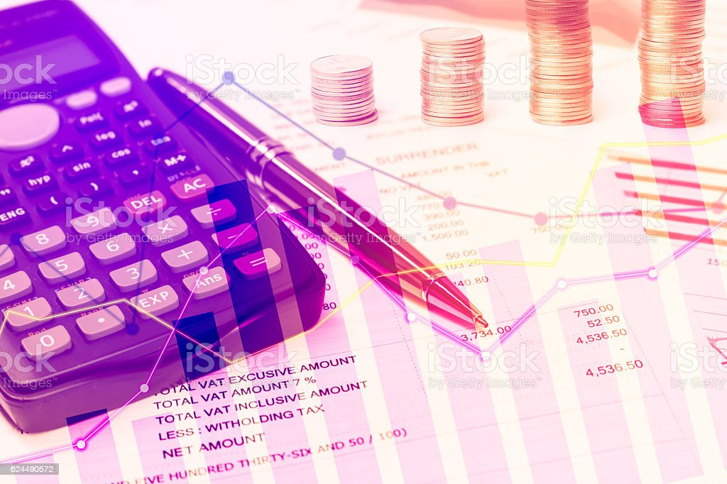 Calculator and pen with graph, coins for finance stock photo