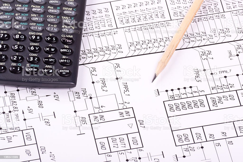Calculator and pencil on drawing royalty-free stock photo