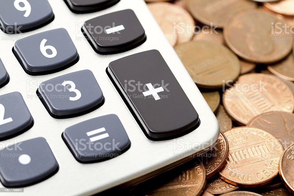 Calculator and Pennies royalty-free stock photo