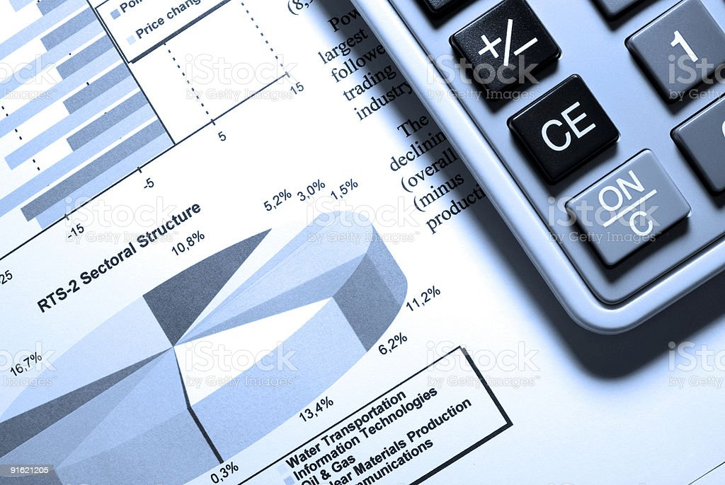 Calculator and printed data with diagrams. stock photo