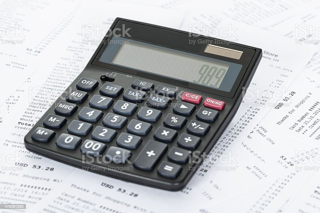 Calculator and Receipts With Costs stock photo