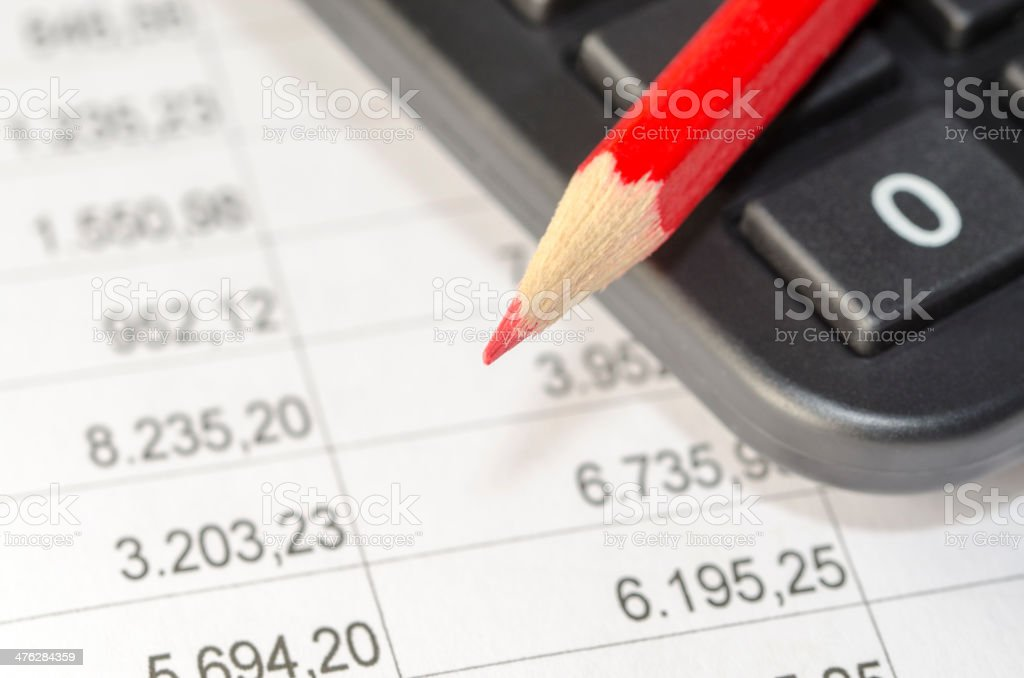 calculator and red pen stock photo