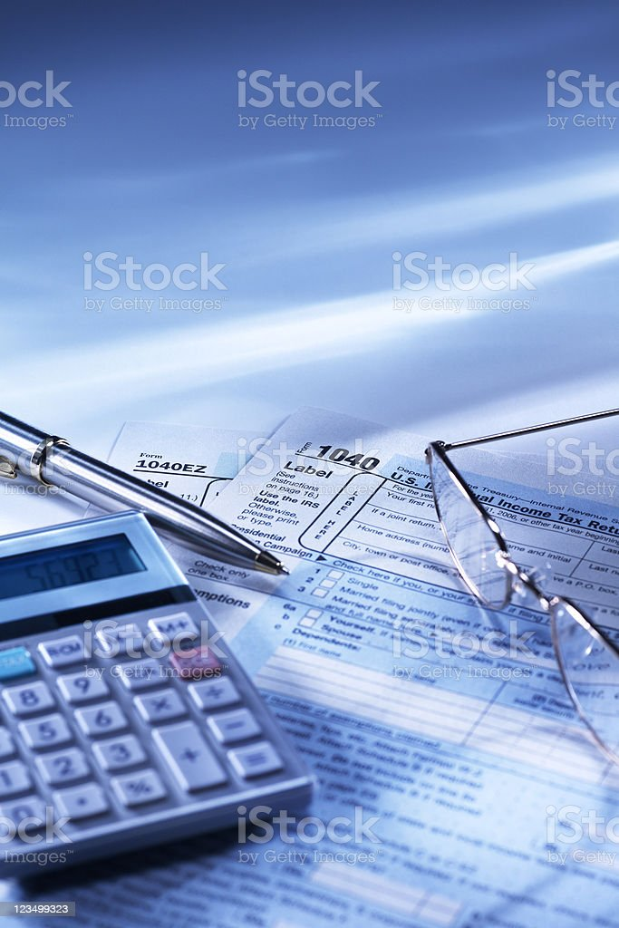 Calculator and Tax Returns royalty-free stock photo