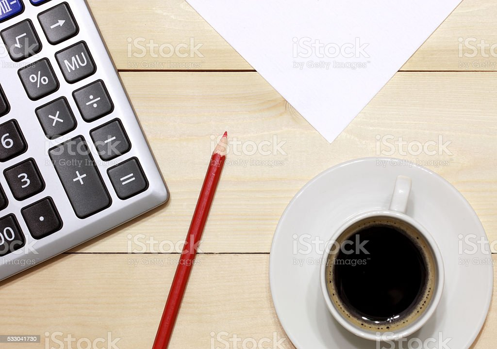 Calculator, coffee, paper and pencil stock photo