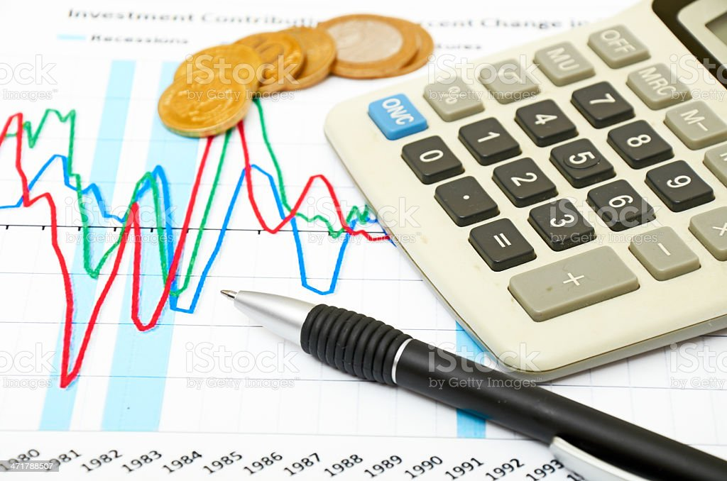 Calculator, coins and pen laying on chart royalty-free stock photo