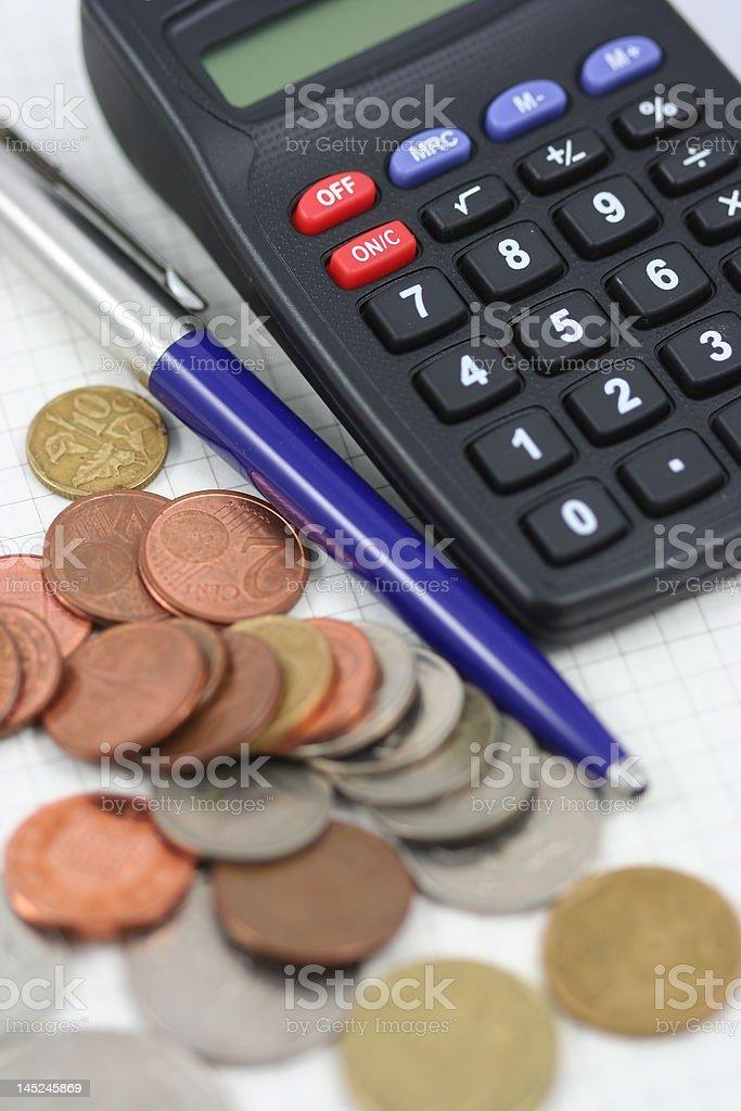 Calculator, coins and pen stock photo