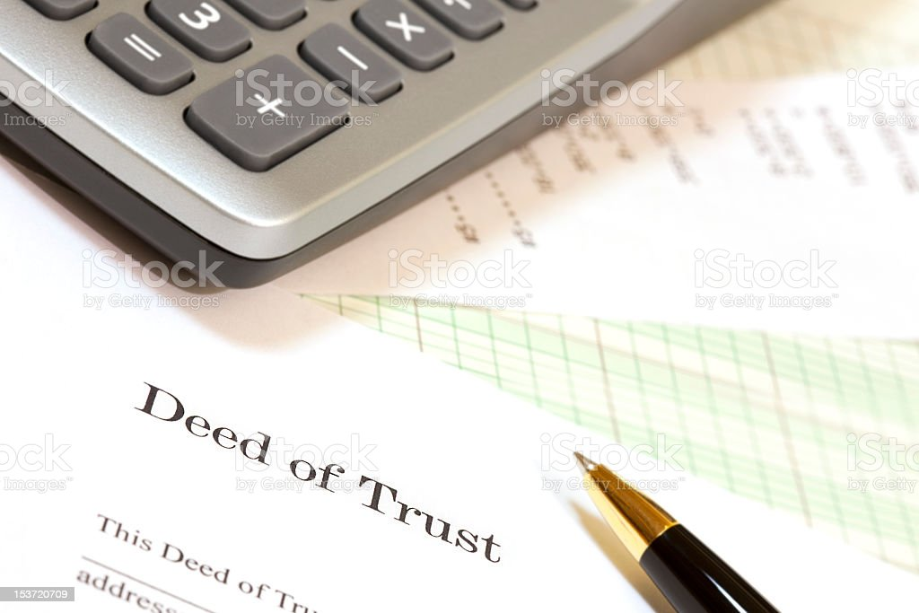Calculator, Deed of Trust Form, Writing Instrument stock photo