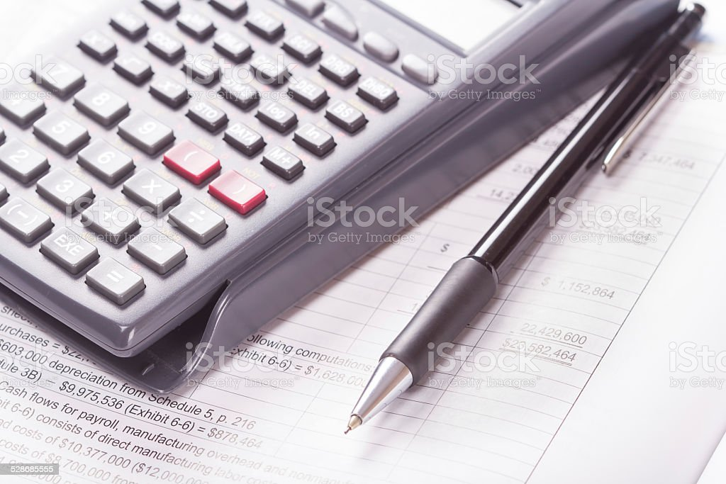 Calculator, financial statement, pen stock photo