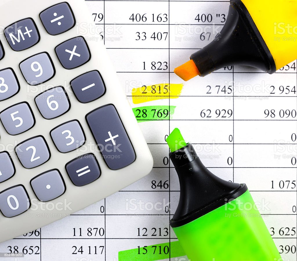 Calculator, highlighter markers on financial statements. stock photo