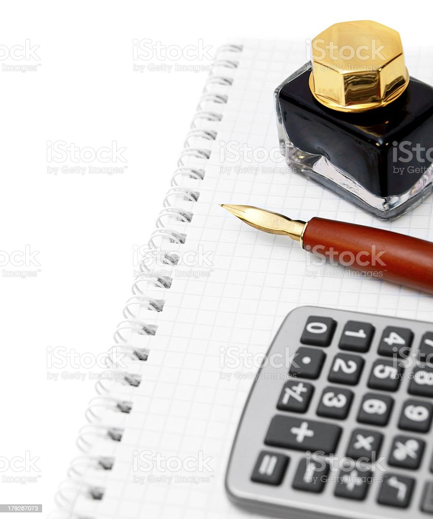Calculator, ink and pen on a notebook. royalty-free stock photo