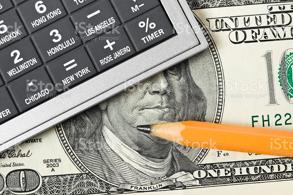 Calculator, money and pencil stock photo