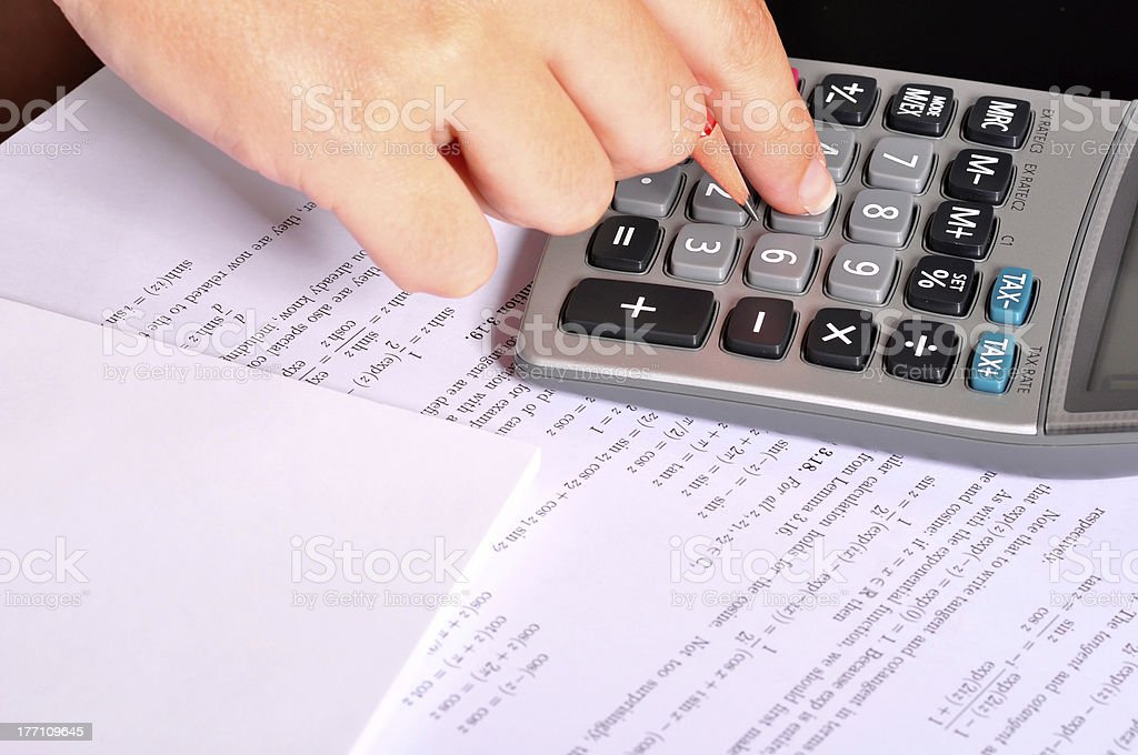 Calculator Next to Maths Exercices royalty-free stock photo