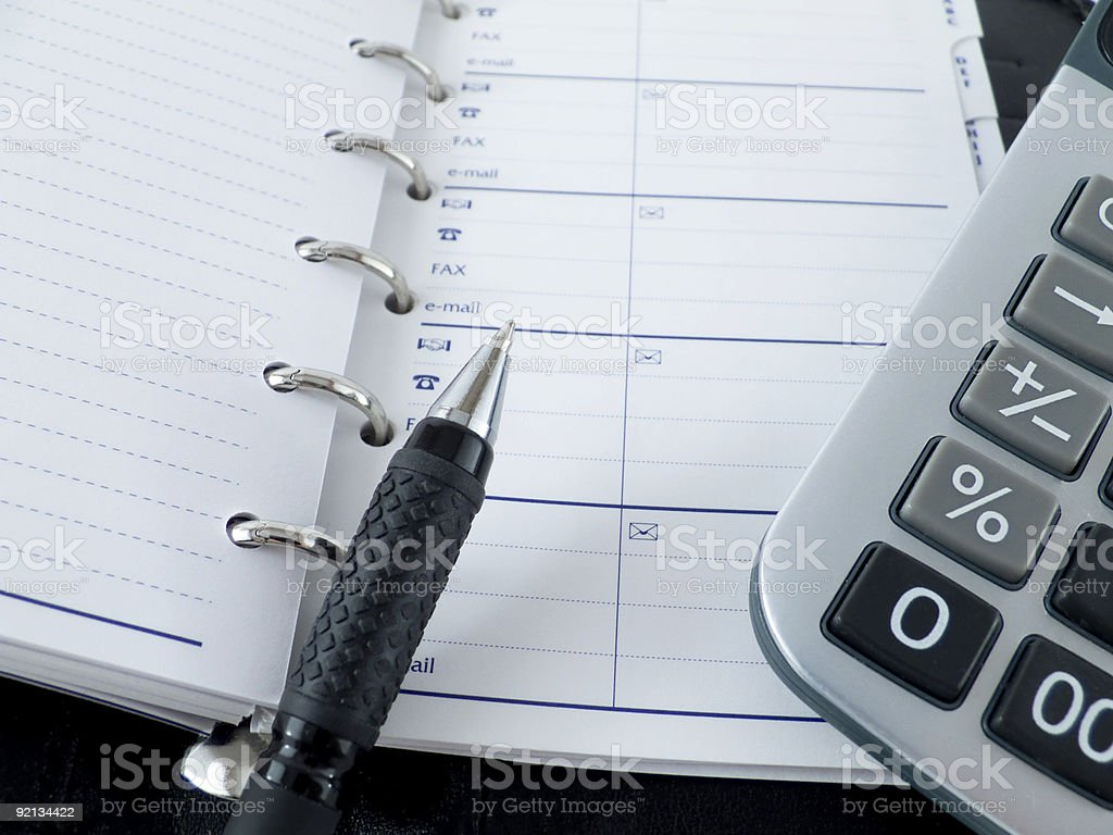 calculator notebook and pen royalty-free stock photo