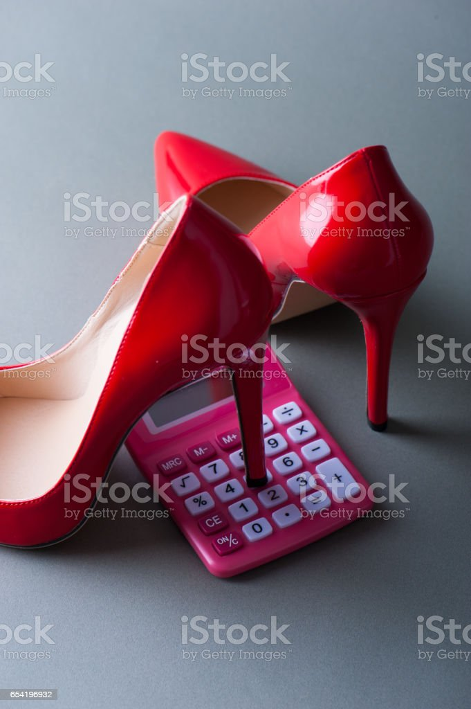 Calculator of the pink and Red high heels stock photo