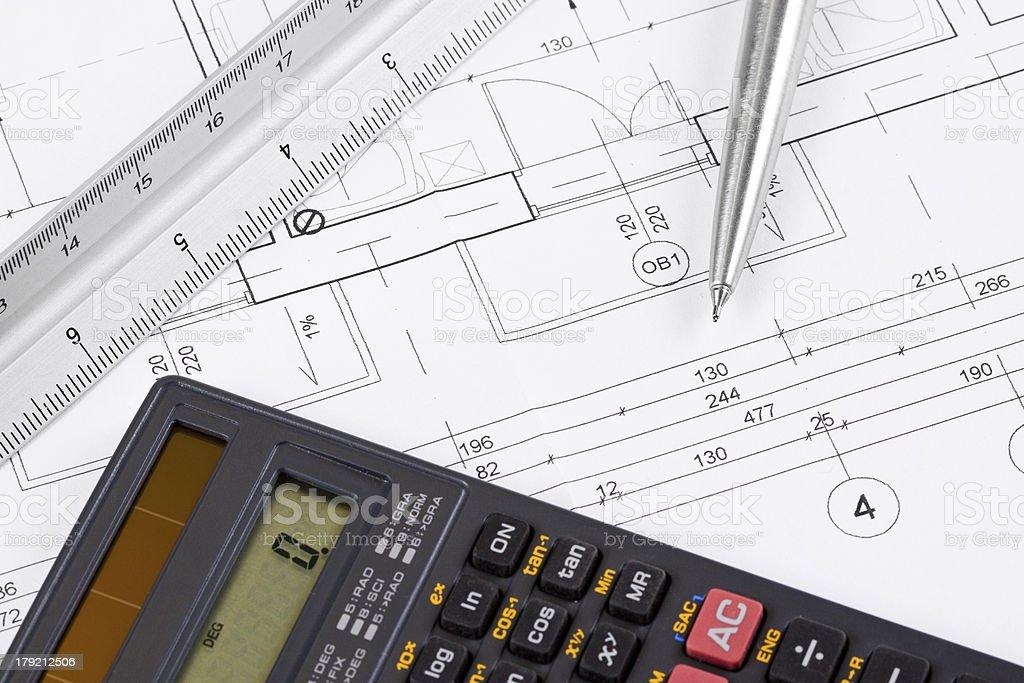 Calculator on a blueprint royalty-free stock photo