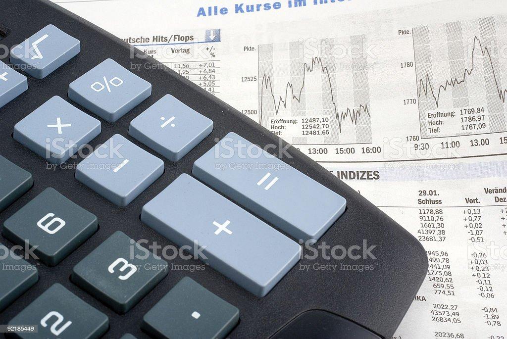 calculator on a financial newspaper stock photo