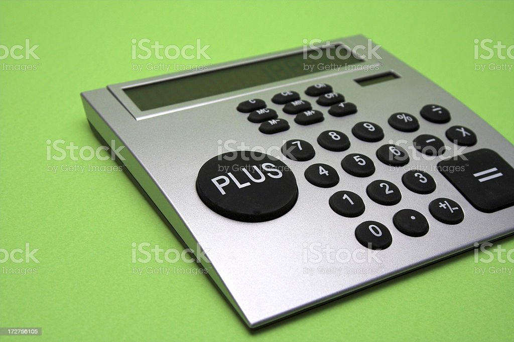 Calculator on a green background stock photo