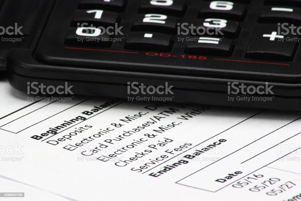 Calculator on Bank Statement stock photo